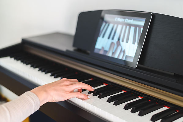 caucasian woman learning to play piano w