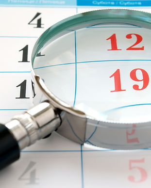 magnifying glass and a calendar to find