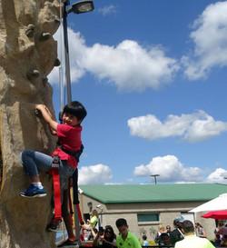 Kid climbing on the climbing wall