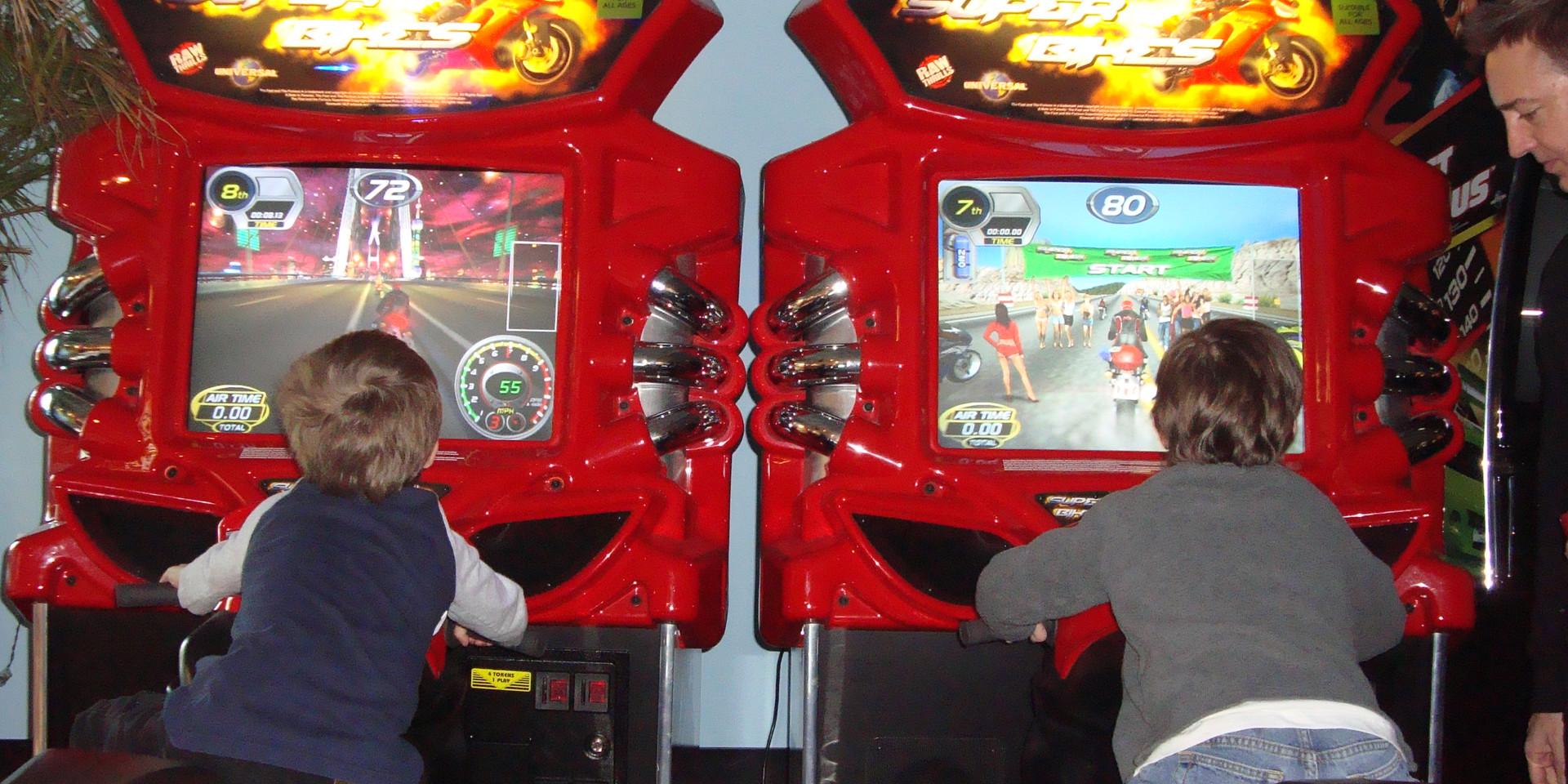 kids playing car racing during field trip
