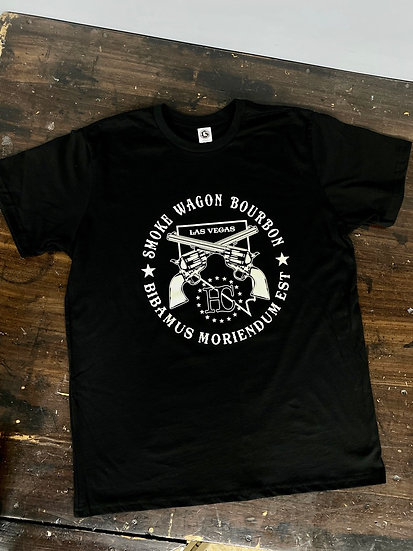 Smoke wagon logo tee on black cotton with ivory colored graphics