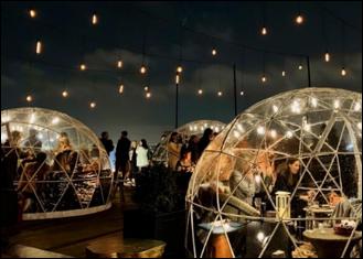 Customers enjoying their meals inside a Covid safe igloo