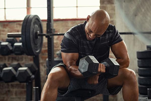 bigstock-Muscular-guy-lifting-dumbbell--