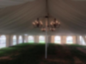 Chandeliers with draping in pole tent
