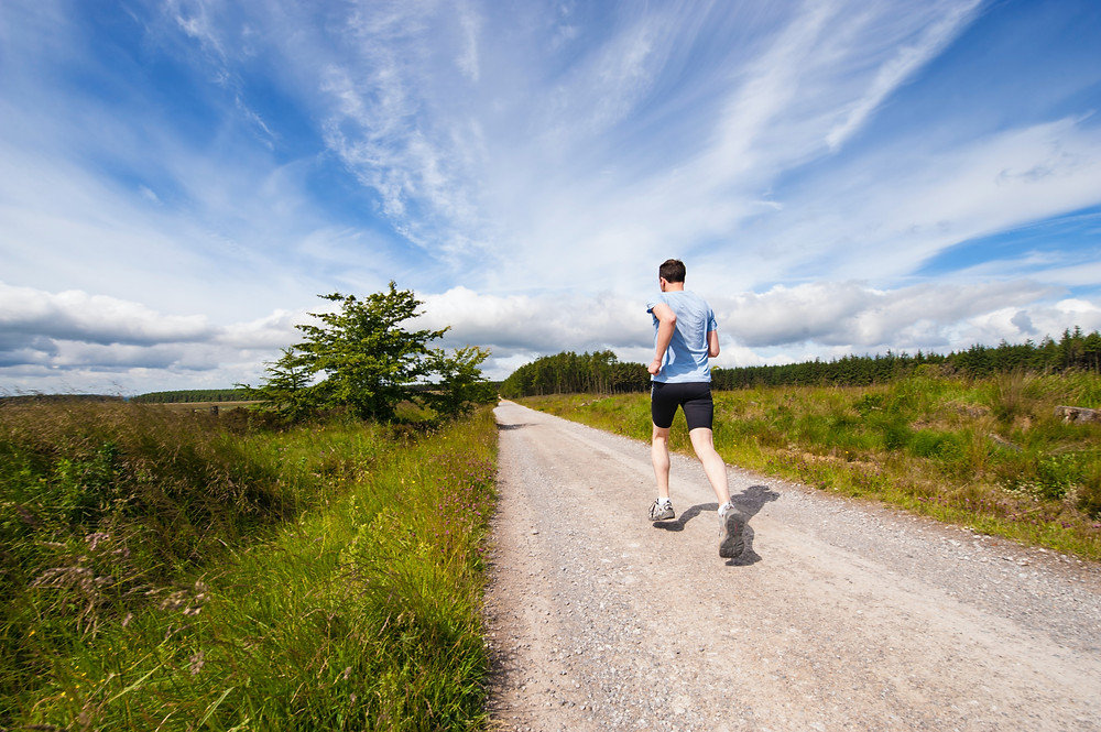 Man running on a country road