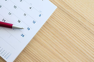 calendar page on wood table background w