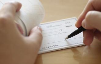 Businessman prepare writing check in the