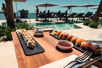 sushi-roll-on-tray-and-table-3475617.jpg