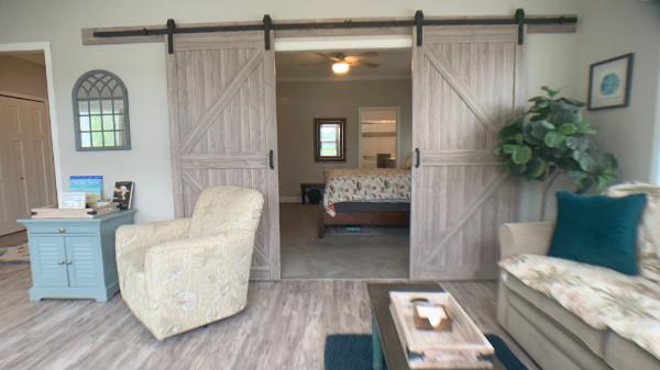 Florida room with barn doors to Master Bedroom
