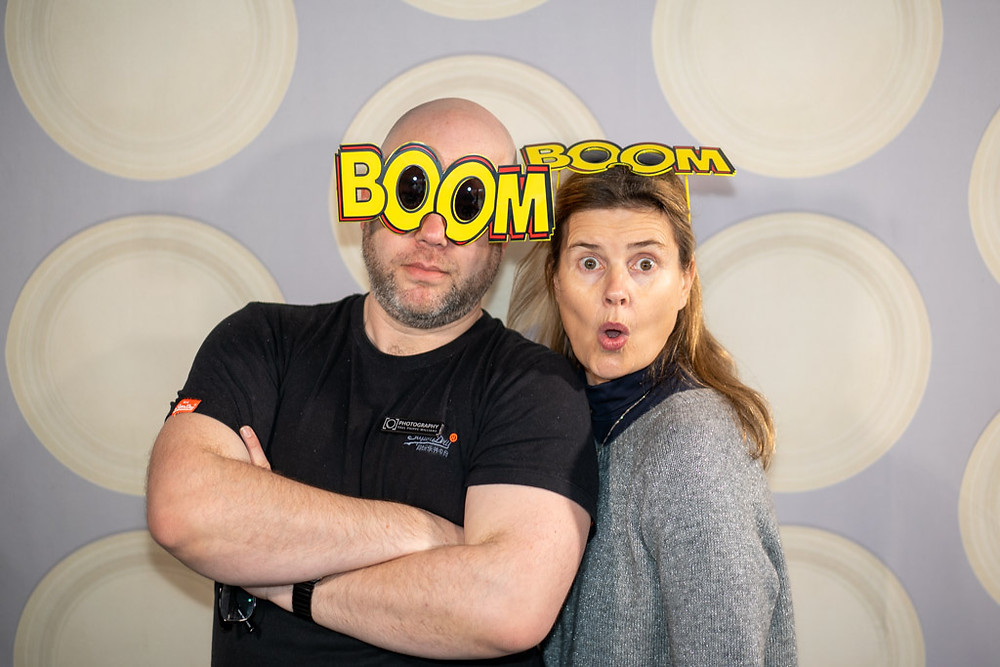 Paul Phipps-WIlliams and Sophie Aldred wearing Boom Glasses