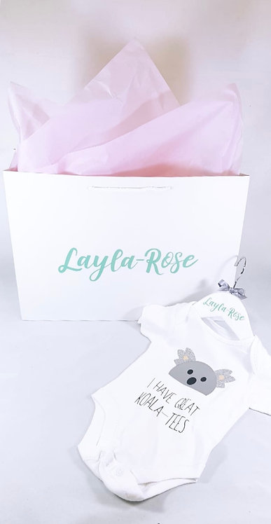 Personalised baby gift, baby vest with koala, personalised name hanger and matching gift bag from riva gifts in Weston uk