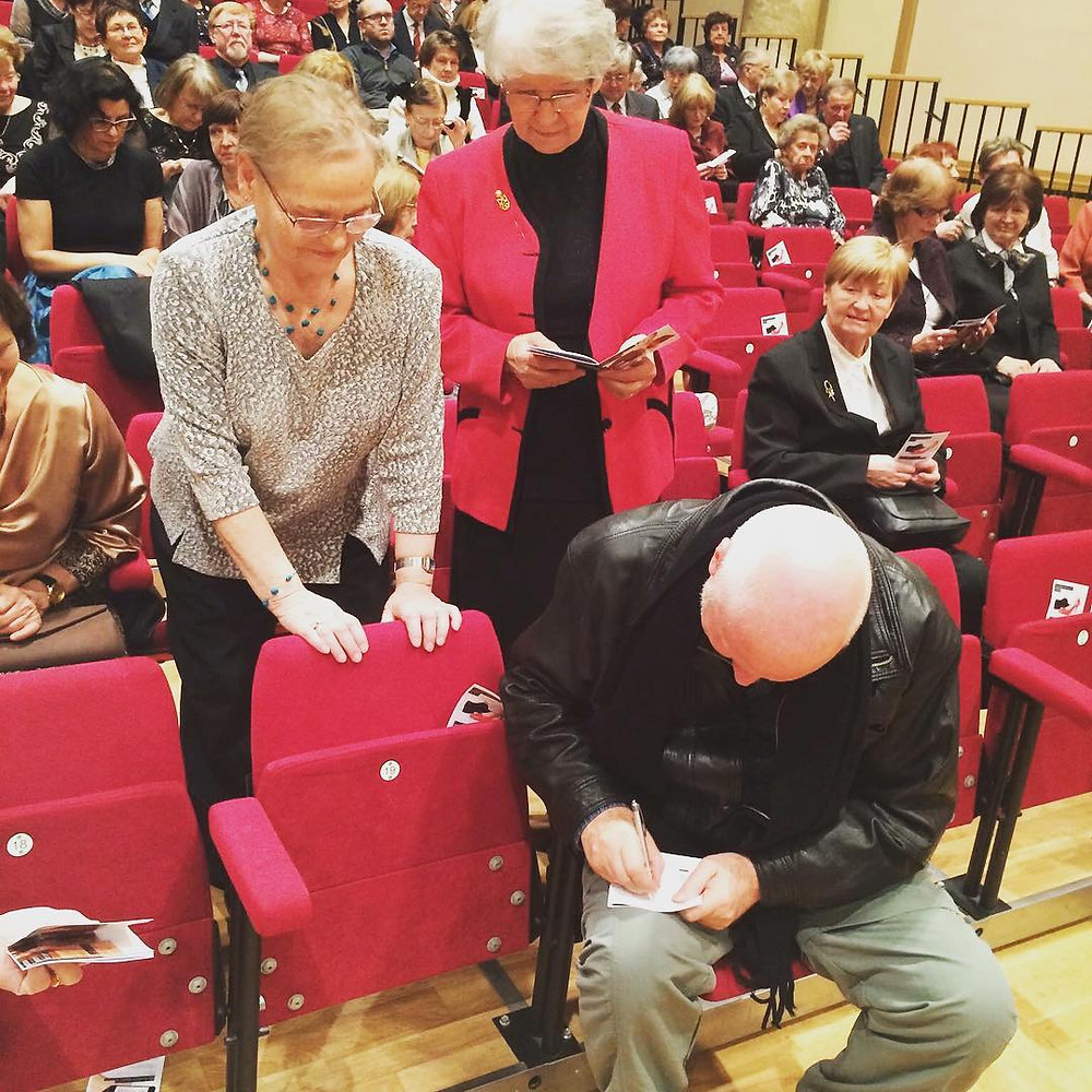 "Mark John McEncroe signing autographs after world premiere concert performance of ""The Passing"""