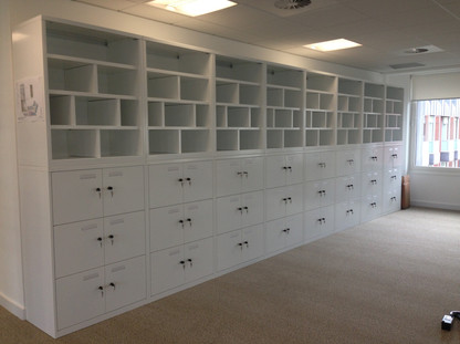 Metal office locker and top sections
