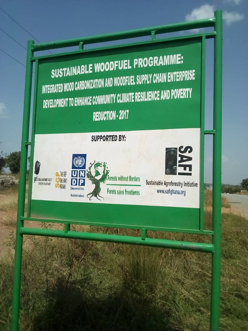 Sign in Mawule Village where FwB is helping people restore forests by reducing fire on the landscape and improving the income of villagers by plantation-based fuelwood production.