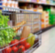 cart-in-supermarket-blurred-from-side_la