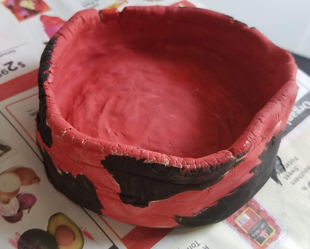 Juju's coil a scrape bowl painted red with black spots.