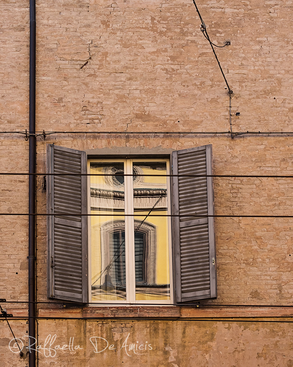 window with reflection in Modena, Italy