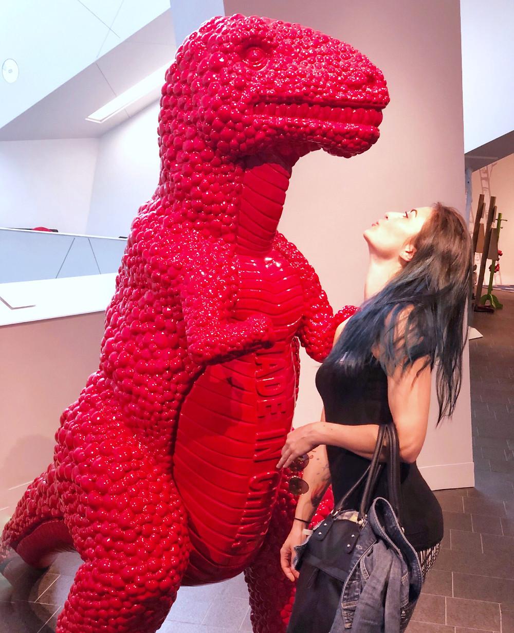 woman with trex art Denver Art Museum