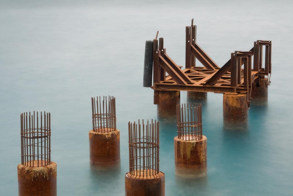 seaside rusty pier long exposure photo
