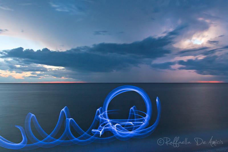 light painting on beach at dusk long exposure