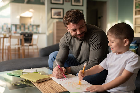 happy-father-and-son-drawing-pictures-to
