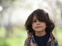 boy-facing-camera-selective-focus-photog