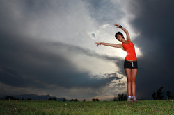 Canva - Woman Flexing Arms on Grassy Land (1)