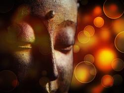 Buddhist Statue on Bokeh Background