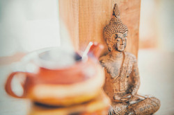 Canva - Meditating Buddha Wooden Statuette