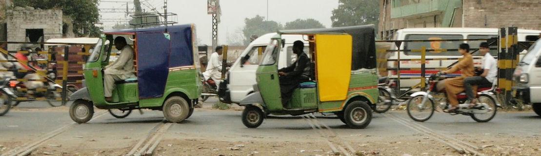 Pink Rikshaw female driver report Pakistan