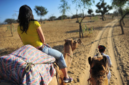 Riding a camel in the Jodphur desert in Rajasthan India