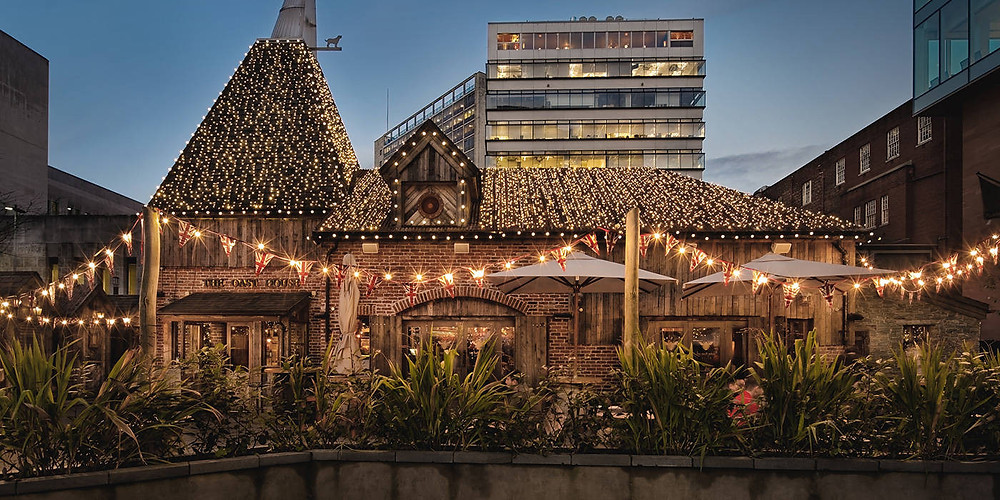 exterior of Neighbourhood Restaurant with twinkle lights at dusk