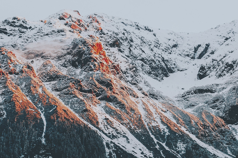 image of snowy mountains at sunset