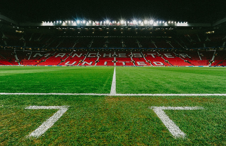 empty stadium and field at Manchester United