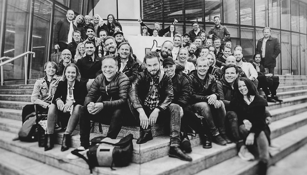 group picture of SEMPRO sitting on steps in front of Facebook Office, Dublin