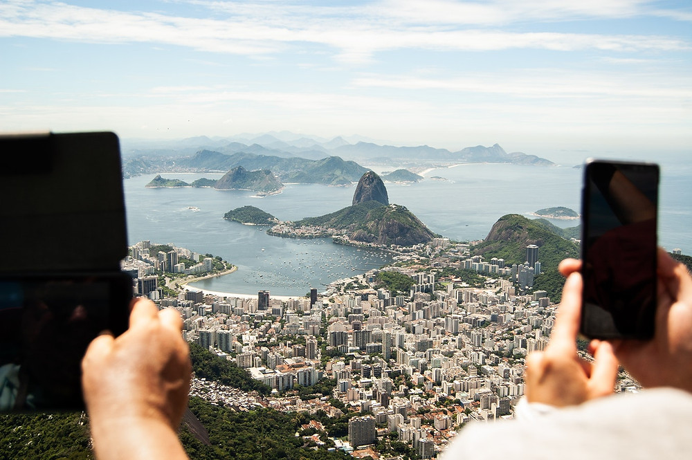 two people taking photos of South Africa from above