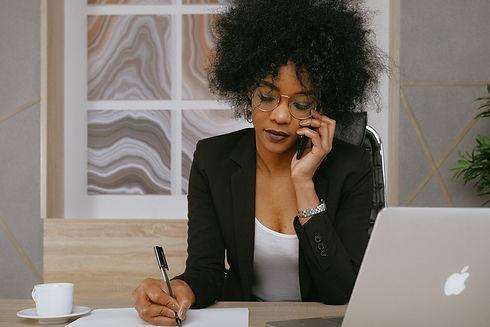 woman-in-black-blazer-holding-smartphone