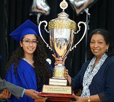 Sathya Sai student winning an award
