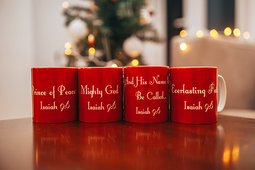 Four red Christmas mugs with white text taken from Isaiah 9:6