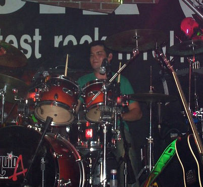 Drum lesson teacher Dan playing at a show