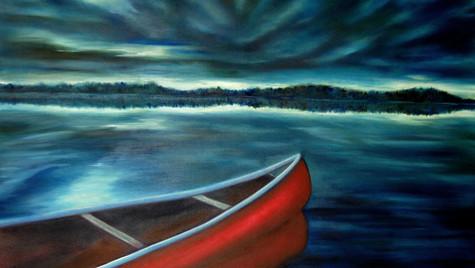 Red canoe at dusk