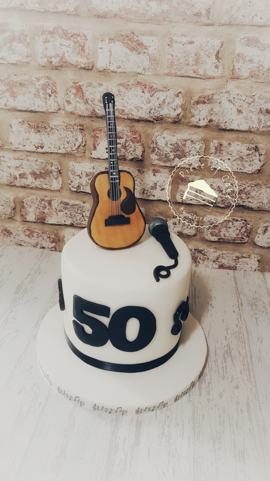 Guitar And Microphone Toppers On A 50th Birthday Cake For Him