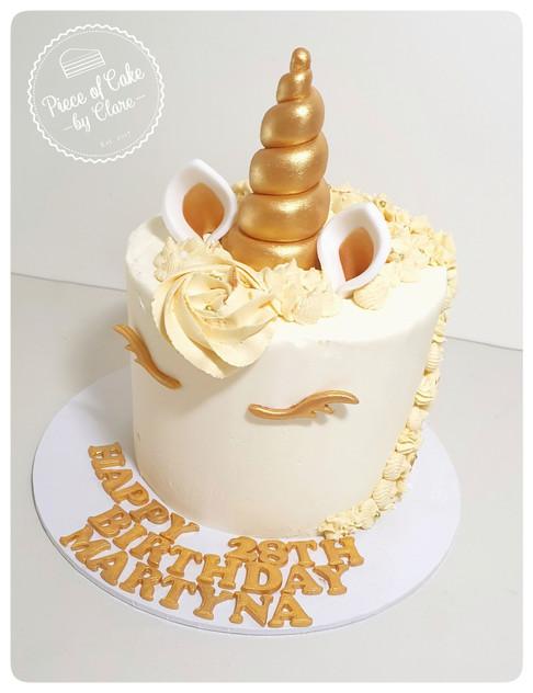 Unicorn cake gold and cream themed