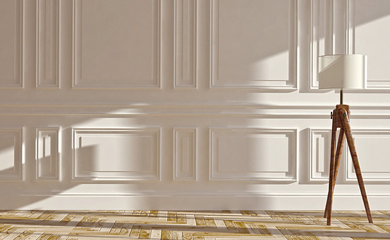 feature wall with white custom molding custom wood floors