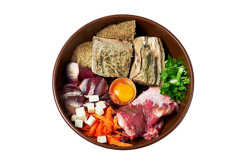 Bowl of natural raw dog food isolated on
