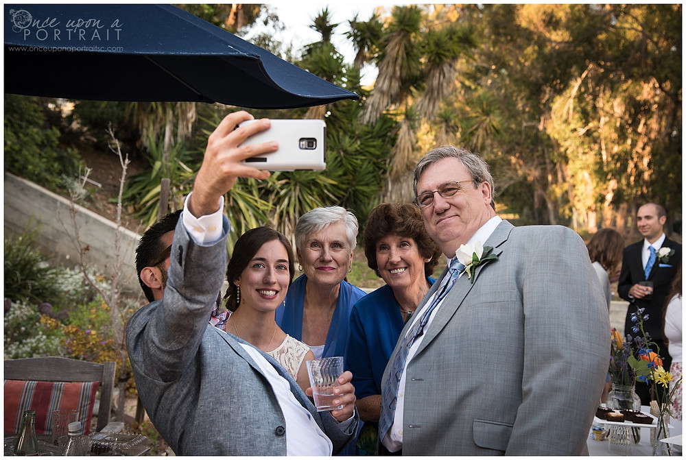 malibu beach wedding reception selfie bride family