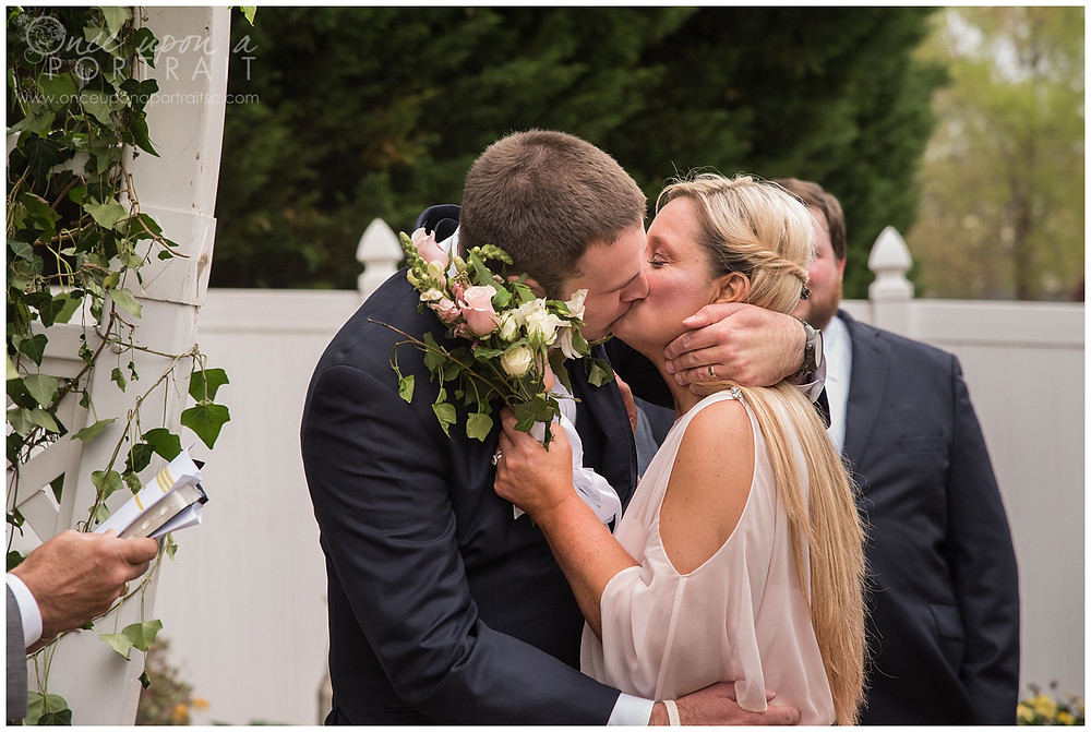 simpsonville backyard intimate wedding first kiss bride groom