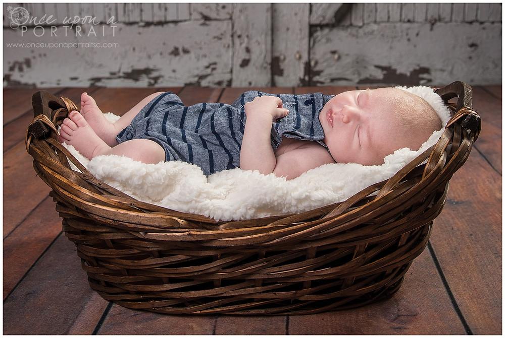newborn baby boy studio session sleeping overalls fuzzy soft basket