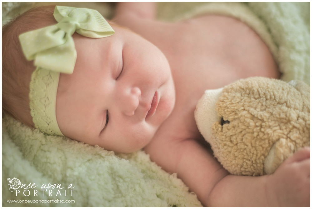newborn baby girl with mom antique teddy bear stuffed animal session with green headband in Simpsonville South Carolina