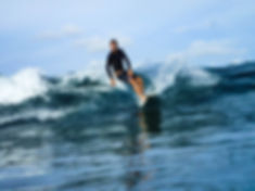Founder of Kura Kura Surf Camp Lombok surfing a wave